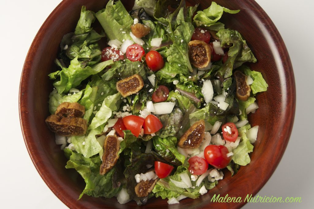 A green salad with dried figs