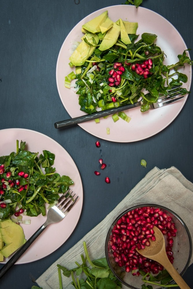 Watercress Salad with pomegranate seeds and avocado.