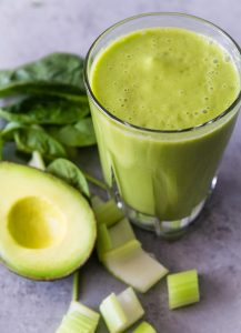 Half avocado smoothie with celery, spinach and almond milk.