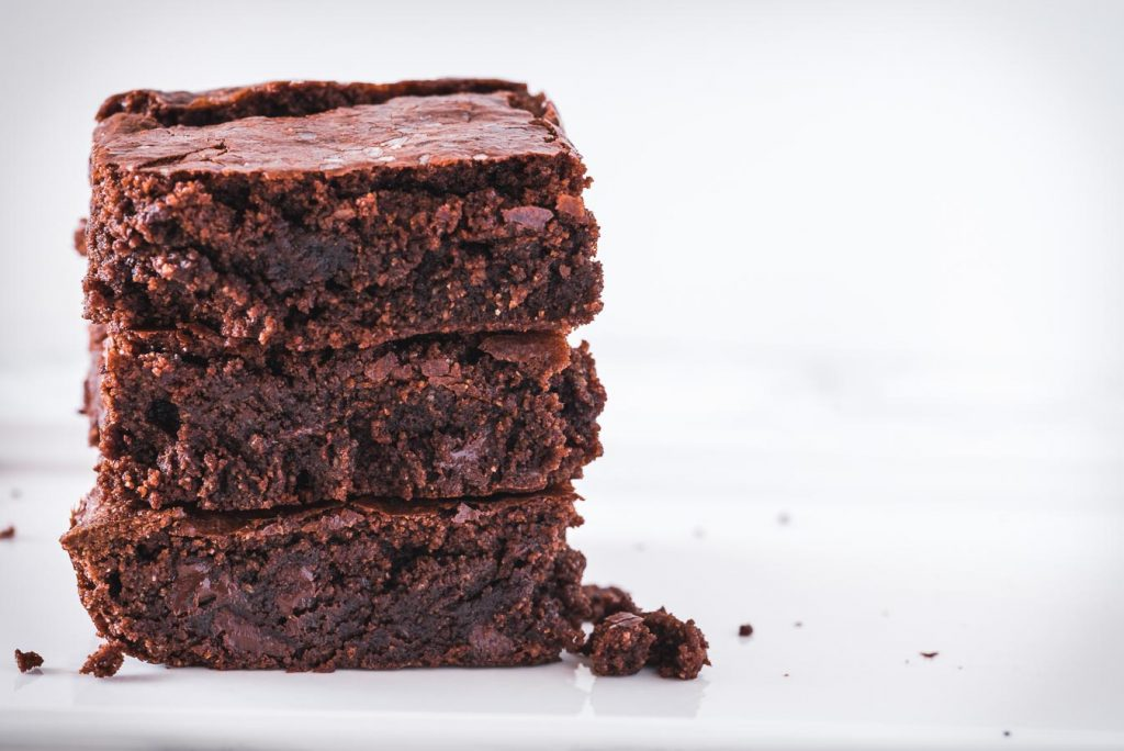 Stack of three gluten free brownies made with almond flour.