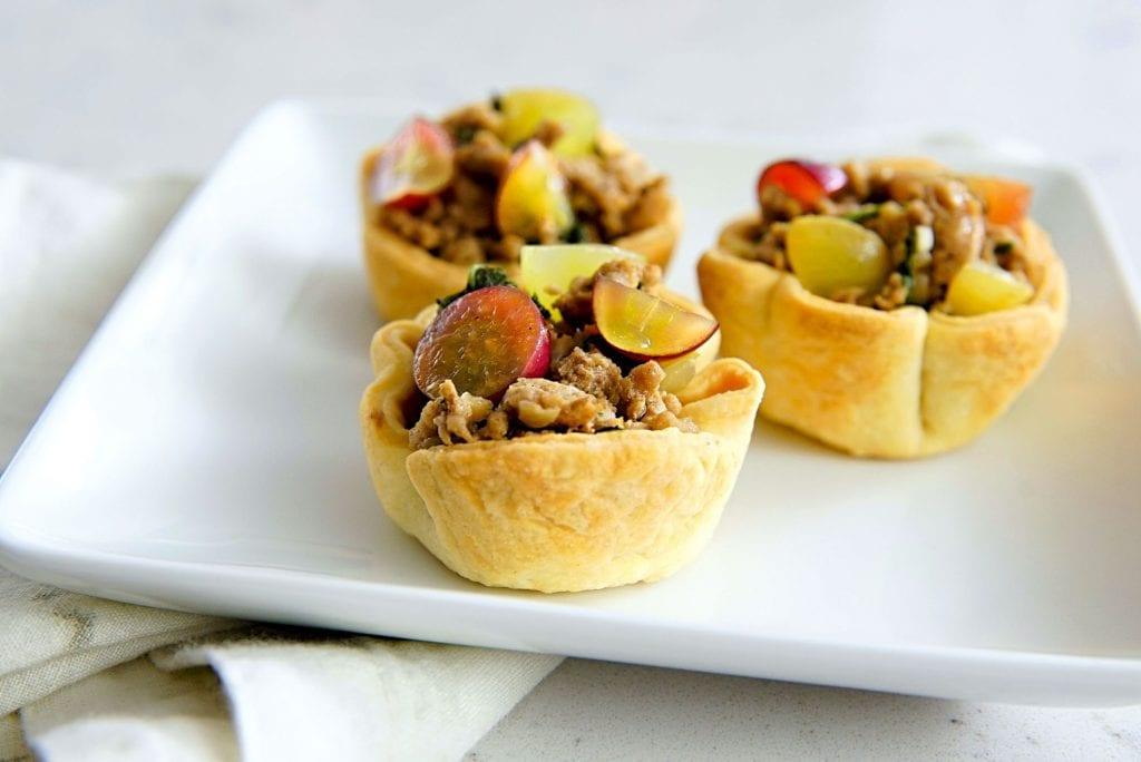 Empanada cups with grapes.